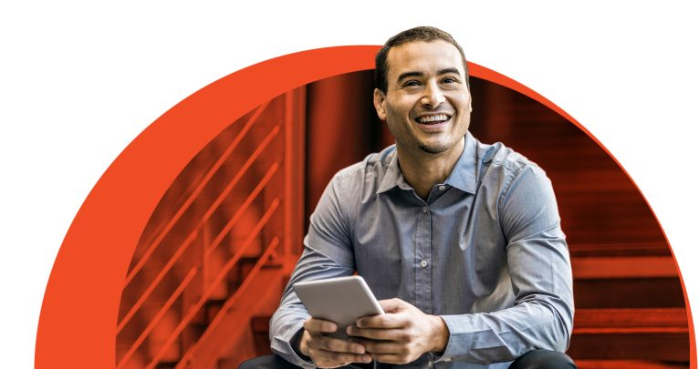 Man smiling with mobile device