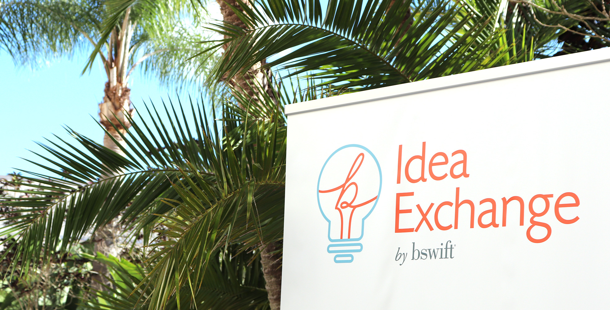Idea Exchange 2019 Sign and Palm Trees