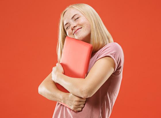 Woman hugging laptop